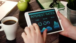 Checking interest rates data using tablet computer