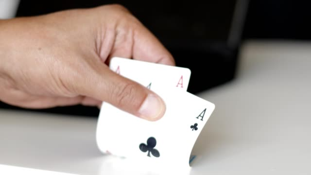 checking play cards - one pair of aces - hand of cards stock videos & royalty-free footage