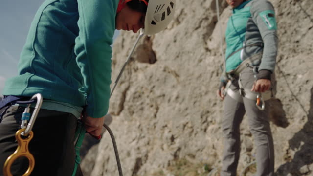 checking safety steps for an outdoor rock climbing - climbing rope stock videos & royalty-free footage