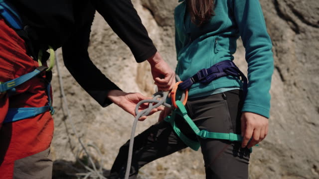checking safety steps for an outdoor rock climbing - safety harness stock videos & royalty-free footage