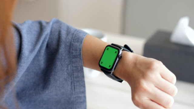 checking smart watch in the morning - smart watch stock videos & royalty-free footage