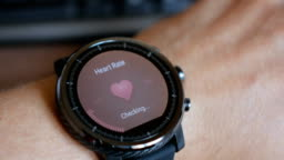 Checking the heart rate by smart watch. Smartwatch. Touching screen. Pulse checking. heart rate monitor
