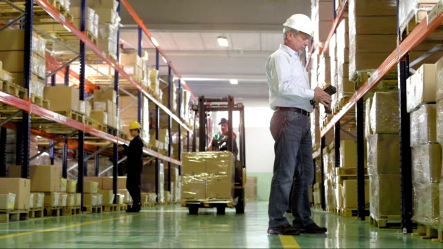 Checking The Stock In A Warehouse