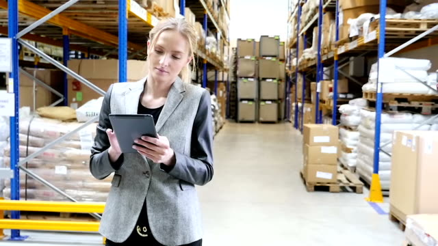 checking the stocks in distribution warehouse - electronic organiser stock videos & royalty-free footage