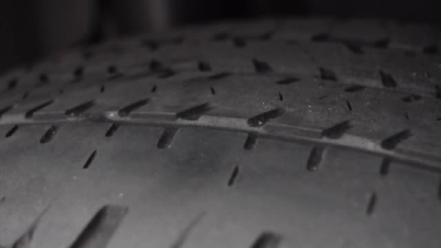 checking tire tread with penny - tire vehicle part stock videos and b-roll footage