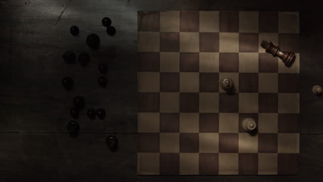 Checkmate - Top view tracking shot over game of chess