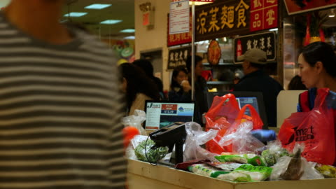 checkout at a chinese food grocery in flushing, queens, new york city - chinatown stock videos & royalty-free footage