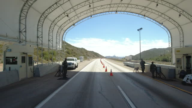 checkpoint in california before entering san diego from the east on interstate 8, border patrol cars arranged along the road. - security stock videos & royalty-free footage