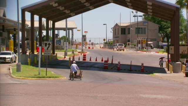 checkpoint on mexico boulevard slight zi on back of unidentifiable cyclist w/ cart meeting w/ two unidentifiable united states border patrol officers... - united states border patrol stock videos & royalty-free footage