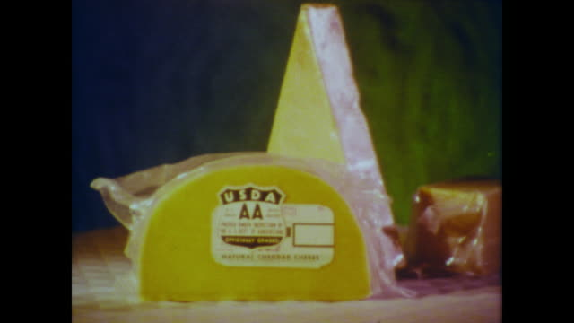 1966 Cheddar cheese showing the different USDA dairy grades go around on a carousel