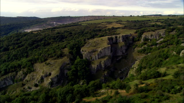 cheddar gorge  - aerial view - england, somerset, sedgemoor district, united kingdom - somerset stock videos & royalty-free footage