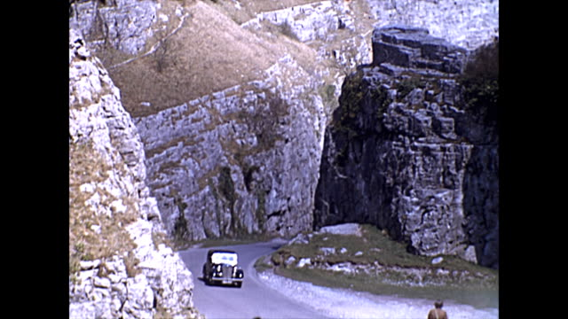 cheddar gorge - old car drives up / cottages / waterfalls / lake and village - somerset england stock videos & royalty-free footage