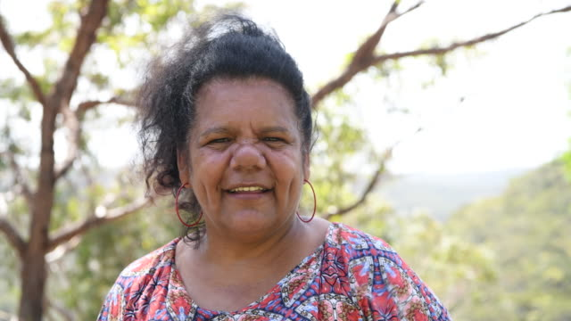 Cheerful Aboriginal woman smiling in the breeze