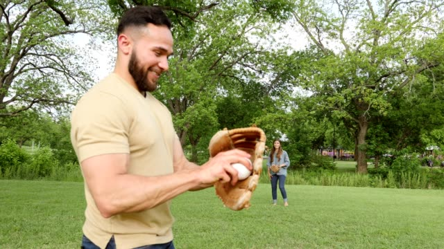 cheerful adult siblings toss baseball during family reunion - baseball sport stock videos & royalty-free footage