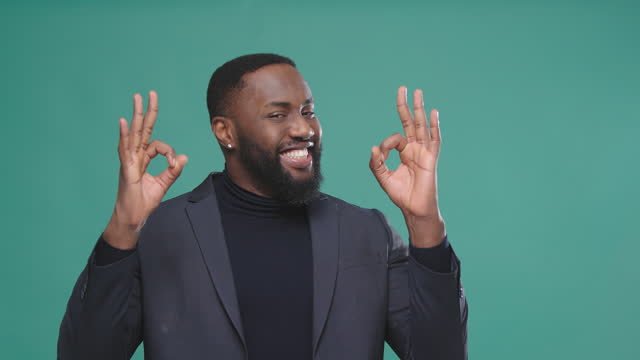 cheerful afro american model raises hands and shows ok sign - gesturing stock videos & royalty-free footage