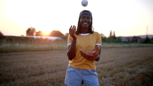 cheerful black girl playing baseball - baseball sport stock videos & royalty-free footage