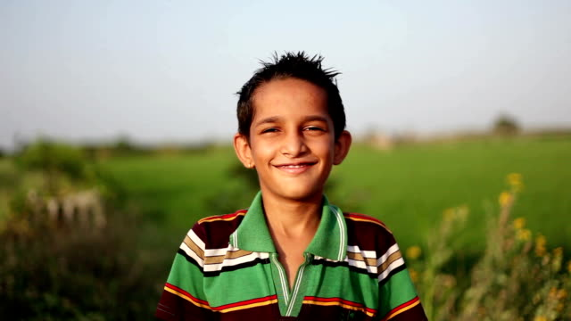 cheerful boy portrait in the nature - lavoratore agricolo video stock e b–roll
