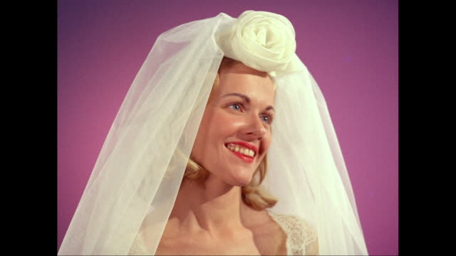 CU Cheerful bride against pink background / United States