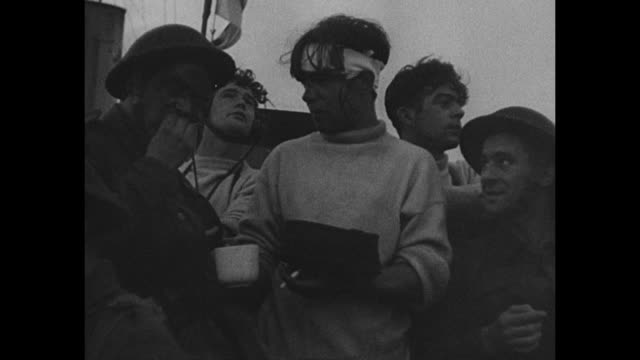 vidéos et rushes de vs cheerful brits wave from ship to men in boat below man in white sweater holds food as others eat aerial view of marshes and river with explosions... - royal air force