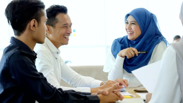 cheerful business colleagues discuss project ideas - hijab stock videos & royalty-free footage