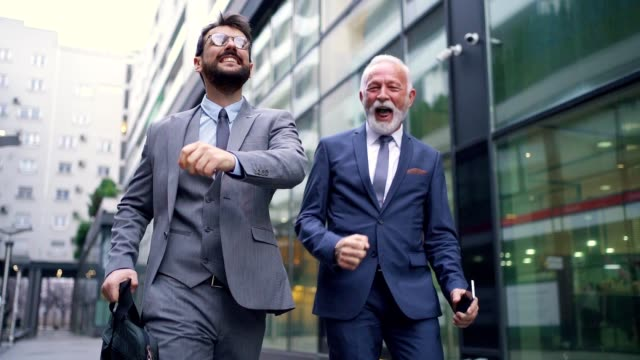 cheerful businessman celebrating their project realisation after company meeting - market trader stock videos & royalty-free footage