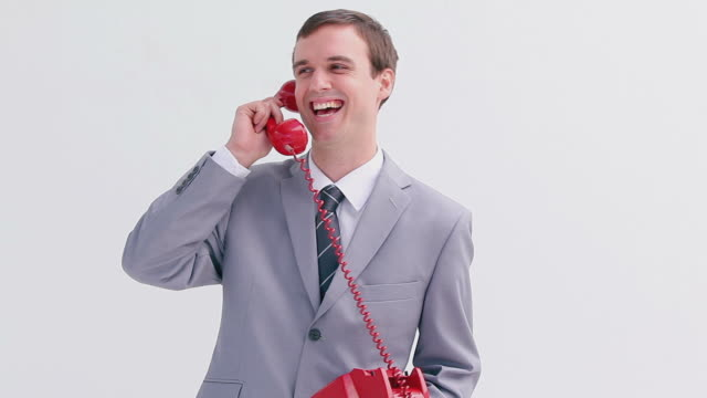 cheerful businessman talking on the phone - kompletter anzug stock-videos und b-roll-filmmaterial
