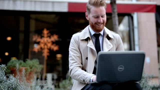 Cheerful businessman with laptop
