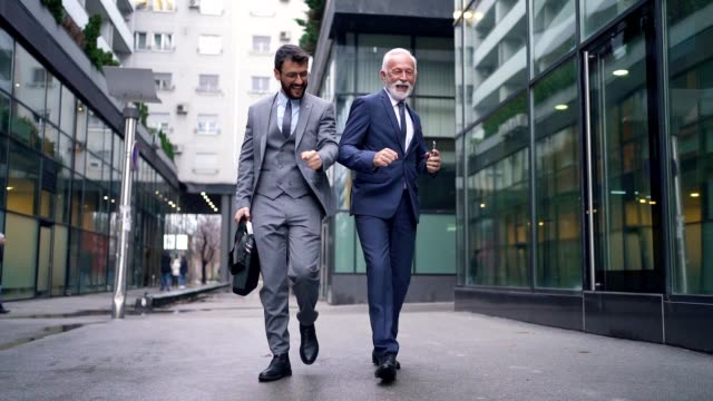 cheerful businessmen dancing around a business district - business person stock videos & royalty-free footage