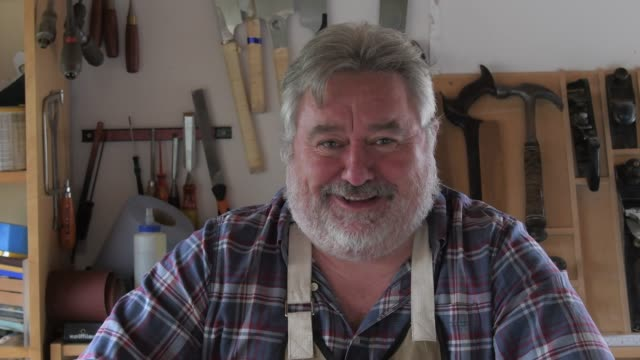 cheerful carpenter portrait in workshop - 50 54 years stock videos & royalty-free footage