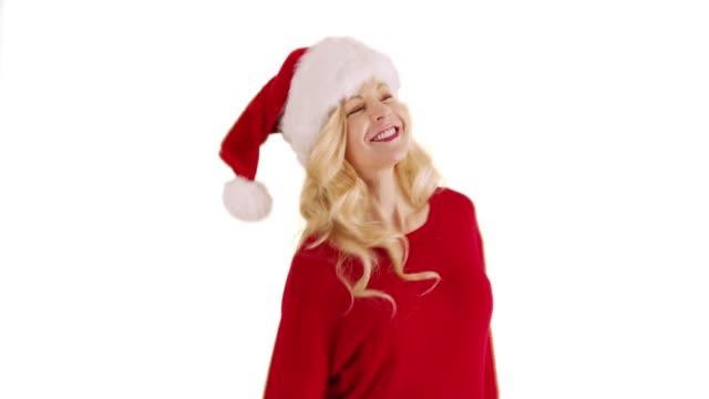 cheerful caucasian woman in festive santa hat dancing and smiling in studio - santa hat stock videos & royalty-free footage