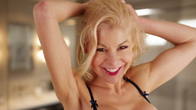 cheerful caucasian woman letting down her hair shaking it out playfully - beautiful people stock videos & royalty-free footage