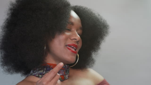 a cheerful charismatic beautiful woman with natural hair - natural hair stock videos & royalty-free footage