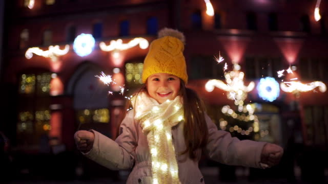 cheerful child dancing on the street on new year's eye - party hat video stock e b–roll