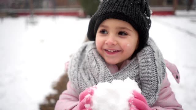 cheerful child eating snow outdoors - childhood stock videos & royalty-free footage