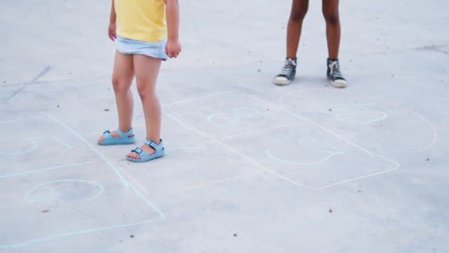 cheerful child playing hopscotch - toddler stock videos & royalty-free footage
