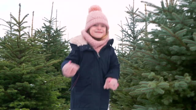 Cheerful child running in coniferous forest