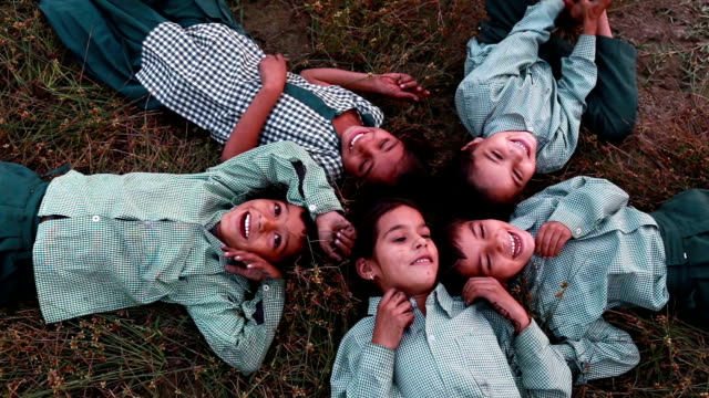cheerful children lying dawn on grass - poor family stock videos & royalty-free footage