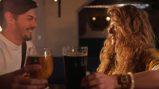 cheerful couple at pub - romantic activity stock videos and b-roll footage
