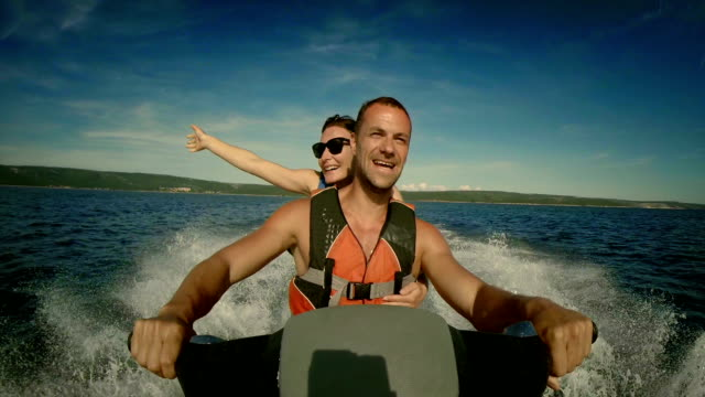 pov cheerful couple on a jet boat - water sport stock videos & royalty-free footage