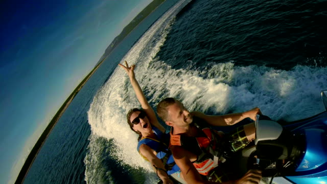 POV Cheerful Couple On A Jet Boat