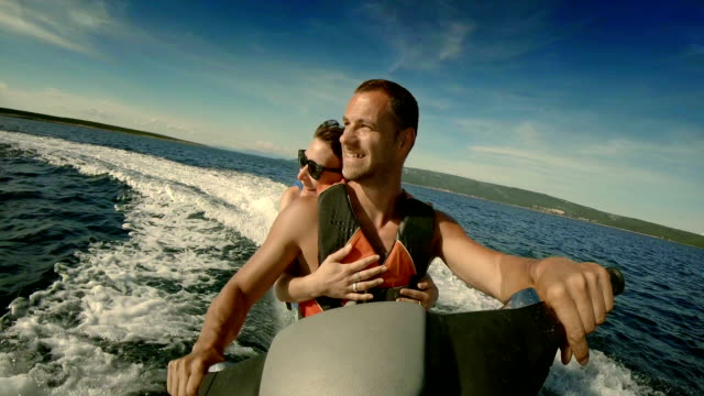 POV Cheerful Couple Riding A Jet Boat