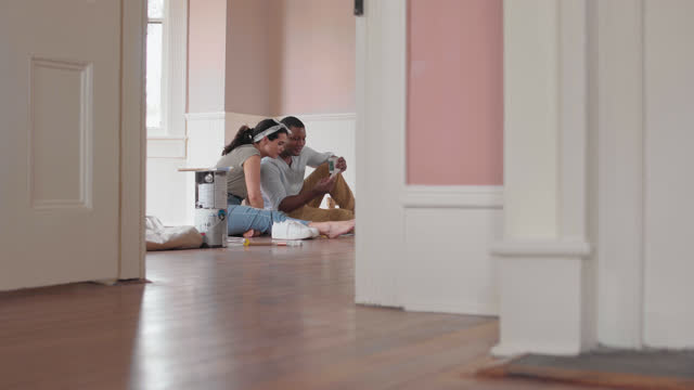 ws cheerful couple sit on the floor of their new home to have a discussion about paint swatches - wilmington north carolina stock videos & royalty-free footage