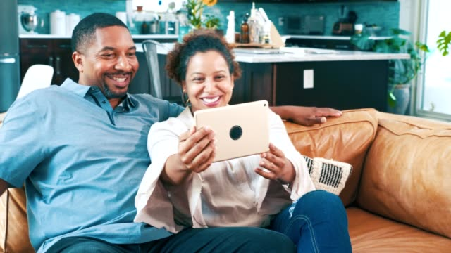 cheerful couple take selfie with digital tablet - mid adult couple stock videos & royalty-free footage