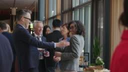 Cheerful entrepreneurs shaking hands during break