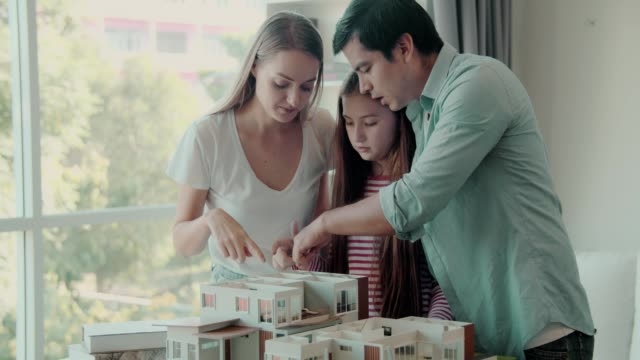 cheerful family enjoy new house model design together - open house stock videos & royalty-free footage