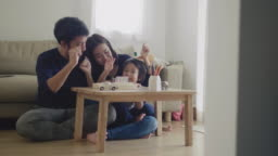 Cheerful Family Playing Wood Toy.
