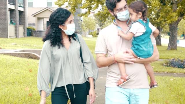 cheerful family walk outdoors during the covid-19 pandemic - husband stock videos & royalty-free footage