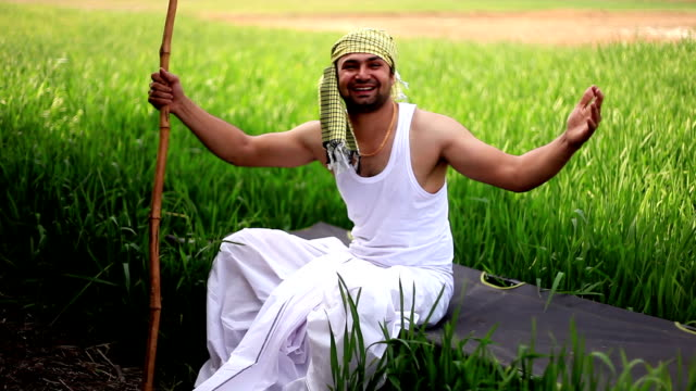 cheerful farmer portrait in the green field - turban stock videos & royalty-free footage