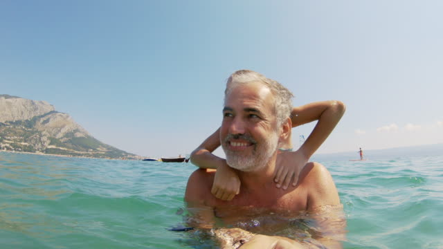 cheerful father and daughter enjoying in sea on summer vacations - modern manhood stock videos & royalty-free footage