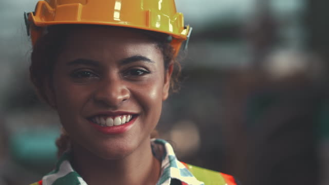 cheerful female engineer - helmet stock videos & royalty-free footage